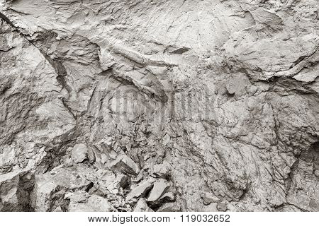 Cliff erosion. Mud, natural clay, cracks in rock background. Natural pattern.