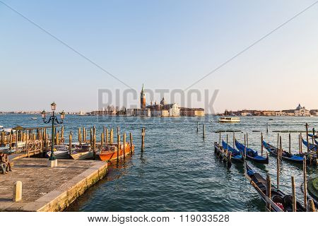 VENICE ITALY - 13TH MARCH 2015: The Church of San Giorgio Maggiore on San Giorgio Maggiore from the San Marco district of Venice during the day. Boats can be seen.