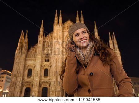 Happy Woman Talking Cell Phone Near Duomo In Evening, Milan