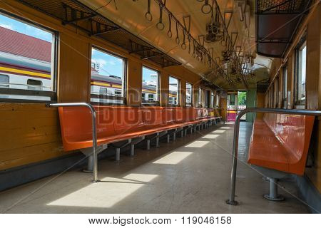 Cabin of a Public Thai Train Railway with wood seat retro.