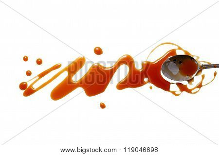 splashes and spilled caramel with a spoon