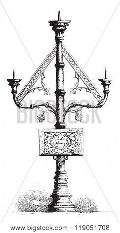 Candelabra with three branches in the church of Saint-Vaast at Gaurian, Belgium, vintage engraved illustration. Magasin Pittoresque 1880.