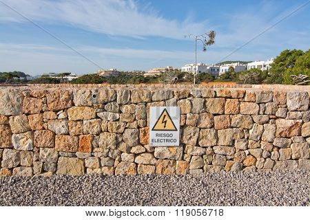 Drystone Wall With Warning Sign For Electricity