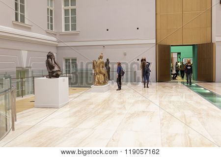 ST. PETERSBURG, RUSSIA - DECEMBER 3, 2015: People in the General Staff building. Eastern wing of the building houses the exhibitions of Hermitage museum after the renovation in 2013