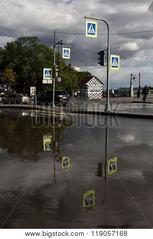 ST. PETERSBURG, RUSSIA - AUGUST 13, 2015: Traffic on a street flooded after heavy rain. The city storm sewer was locally damaged