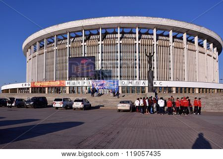 ST. PETERSBURG, RUSSIA - MAY 3, 2015: People in front of the Saint-Petersburg Sports and Concert Complex. Opened in 1980, it is one of the largest indoor sports and entertainment facilities in Europe