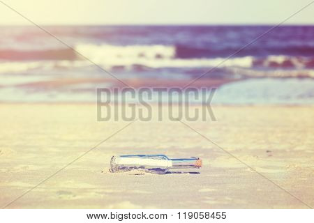 Vintage Stylized Message In A Bottle On Beach, Shallow Depth Of Field