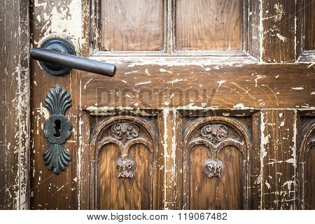 Old Shabby Door With Metal Door Handle.