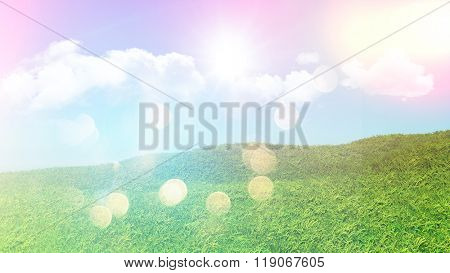 3D landscape of grassy hill with clouds in a blue sky with retro effect