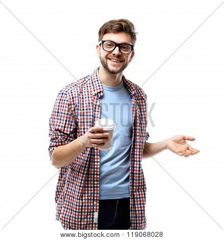 Young man drinking coffee portrait. Smiling happy male university student with drinking disposable c