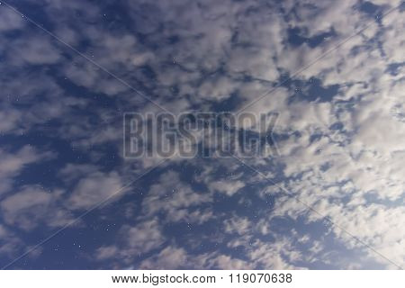 White clouds, blue sky and stars With Constellations Lyra, Draco, Hercules, Cygnus, Corona Borealis