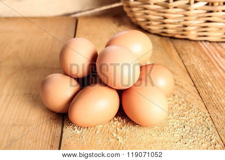 Fresh rural eggs on a wooden board