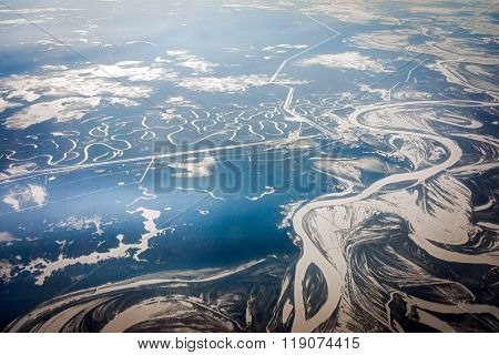 Airplane Panoramic View Of A River In Far East Of Russia With Winter Snow