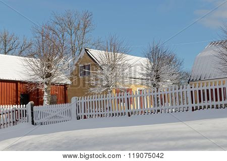 Traditional Yellow And Red Houses In The Wintry Landscape