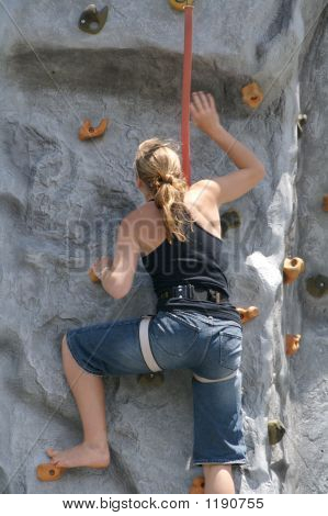A Teenage Girl Climbing