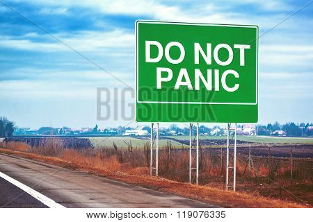 Do Not Panic Road Sign By The Freeway