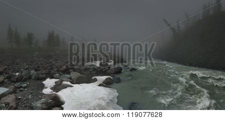 Foggy landscape with mountain river