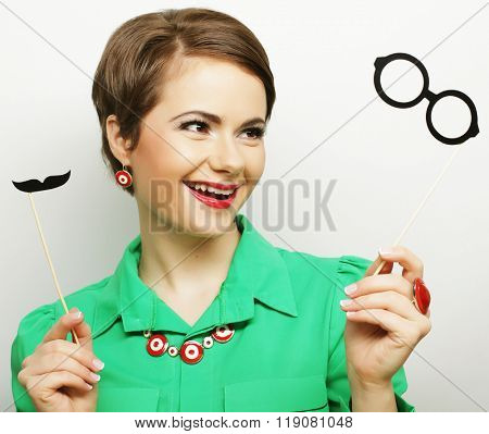 woman holding mustache and glasses