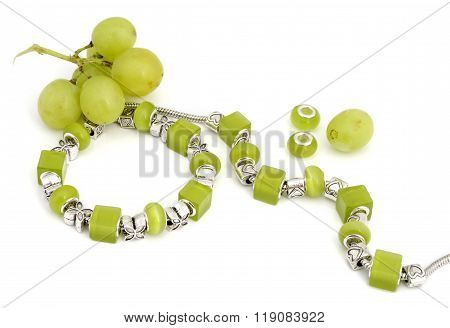 Green pandora bracelet and grapes