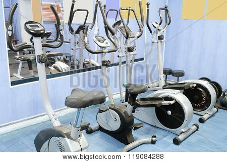 Interior of a fitness hall with the fitness bycicle