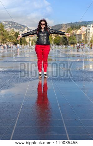 Woman Standing In The Middle Of The Fontaine Du Soleil On Place Massena