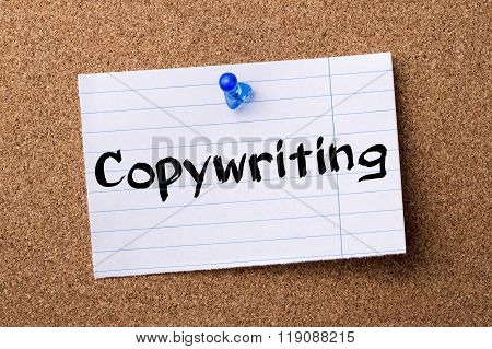 Copywriting - Teared Note Paper Pinned On Bulletin Board