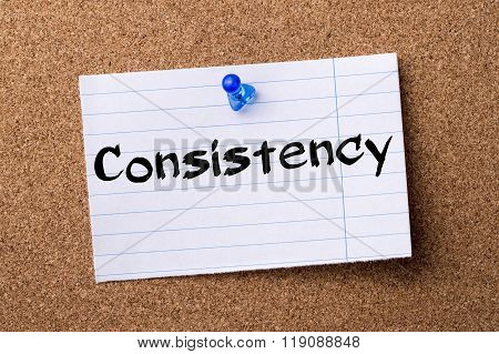 Consistency - Teared Note Paper Pinned On Bulletin Board