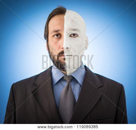 Conceptual two sides face portait photo of a businessman
