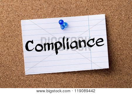 Compliance - Teared Note Paper Pinned On Bulletin Board