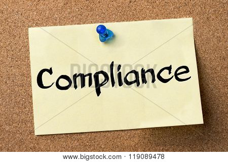 Compliance - Adhesive Label Pinned On Bulletin Board