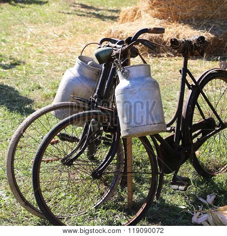 Two Ancient Rusty Bicycles For The Transport Of Milk In The Bin Of Aluminum