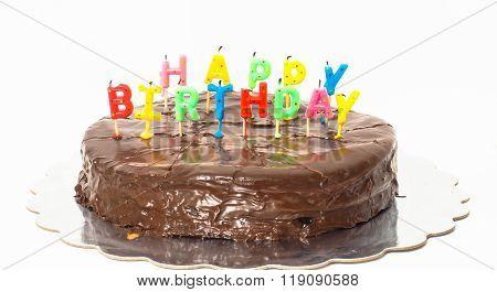 Chocolate Happy Birthday Cake On Silver Tray Towards White