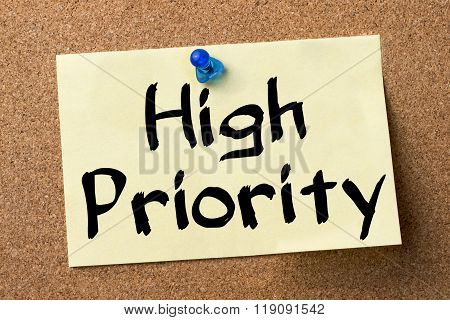 High Priority - Adhesive Label Pinned On Bulletin Board
