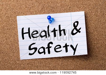 Health & Safety - Teared Note Paper Pinned On Bulletin Board