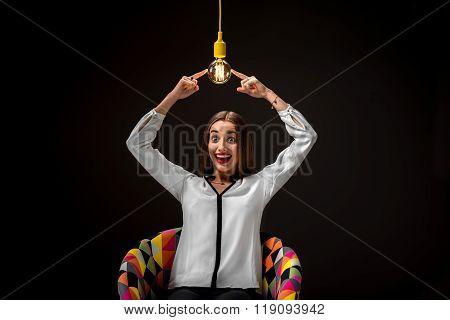 Woman with illuminated retro lamp