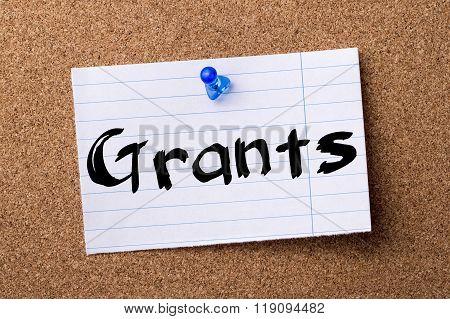 Grants - Teared Note Paper Pinned On Bulletin Board