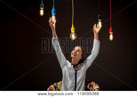 Woman with illuminated retro lamps