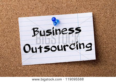 Business Outsourcing - Teared Note Paper Pinned On Bulletin Board