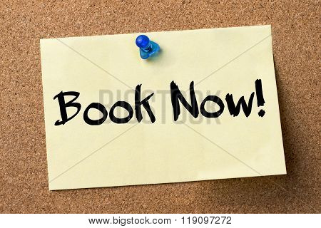 Book Now! - Adhesive Label Pinned On Bulletin Board