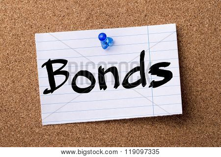 Bonds - Teared Note Paper Pinned On Bulletin Board
