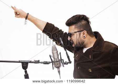 Men Wearing Brown Coat And Glasses Singing Into Condenser Microphone