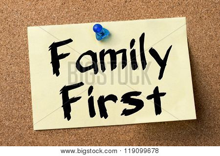 Family First - Adhesive Label Pinned On Bulletin Board