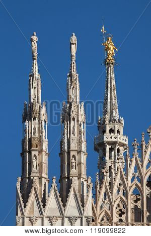 Gilded bronze statue of the Virgin Mary called the Madonnina on the spire of the Milan Cathedral in Milan, Lombardy, Italy.