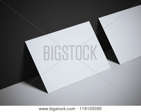 Two blank white business cards