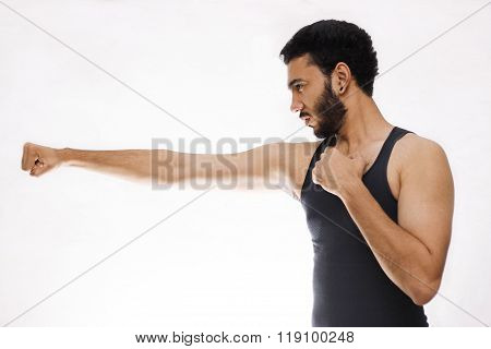 Confident Young Fitness Man With Strong Hands And Clenched Fists