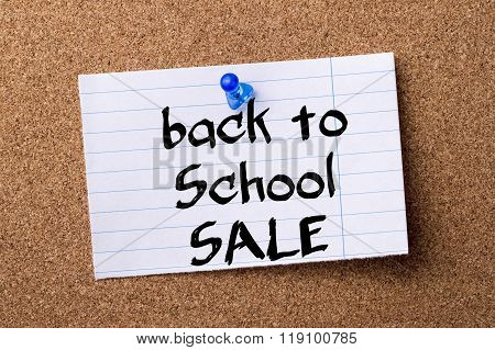 Back To School Sale - Teared Note Paper Pinned On Bulletin Board