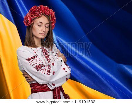 Girl In The Ukrainian National Suit Against Ukrainian Flag