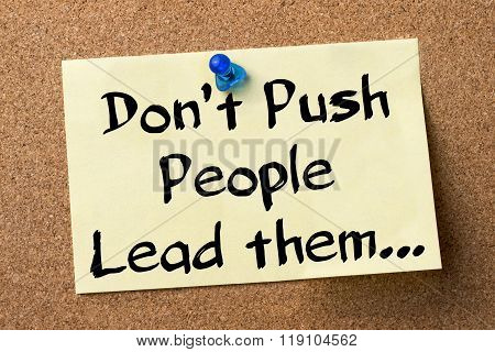 Don't Push People Lead Them… - Adhesive Label Pinned On Bulletin Board