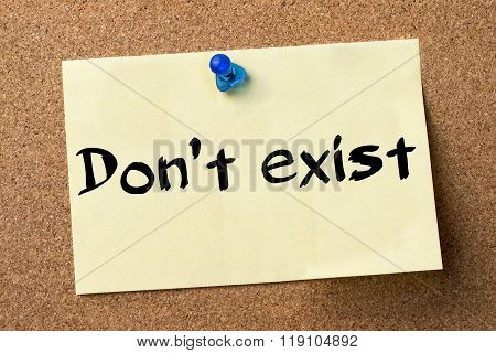 Don't Exist - Adhesive Label Pinned On Bulletin Board