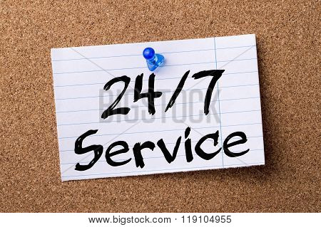 24/7 Service - Teared Note Paper Pinned On Bulletin Board